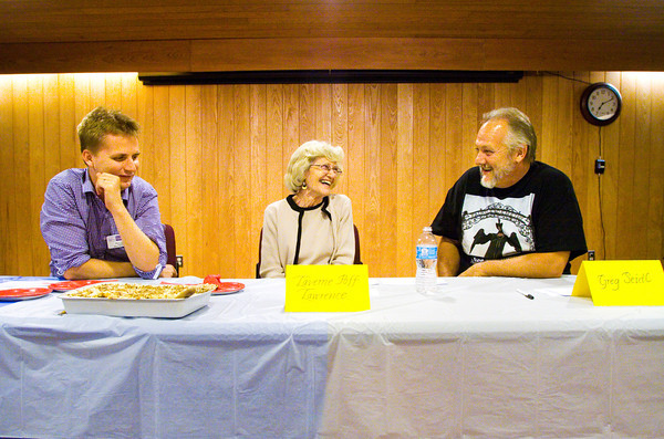 From left, judges Matt Eidem, LaVerne Poff Lawrence and Greg Seidl share a laugh while discussing a tiebreaker for second place during the Bicentennial Bake-off in the Elsa Strassweg Auditorium at the New Albany-Floyd County Public Library in New Albany on Wednesday evening. Recipes for the dishes in the contest were from the New Albany Bicentennial Cook Book that was released late last year. Prizes were awarded to first, second and third place winners by the judges, and participants and audience members were given the opportunity to vote for the people's choice award. Staff photo by Christopher Fryer