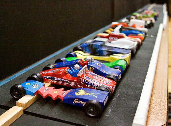 Pinewood derby cars sit in the garage area at the Test & Tune Pinewood Derby Race at Georgetown Christian Church on Saturday morning. More than 30 participants brought their cars to the event to test and tweak their performance before the official race on February 2. Staff photo by Christopher Fryer