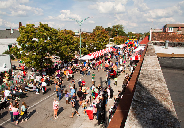 Attendants move between food vendors and booths along Court Avenue during the fourth annual Jeffersonville Italian Festival on Saturday afternoon. Staff photo by Christopher Fryer