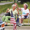 Mary Eddings, left, and Vada Leavitt enjoy the Clarksville Parade as it rolls down Eastern Boulevard Monday afternoon. Staff photo by C.E. Branham