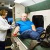 Collection technician Christie Seegars, Elizabethtown, Ky, works with Danny Hylton, Sellersburg, as he donates blood during a special blood drive by the Clark County American Red Cross to benefit Dylan Wiseman, 3, Jeffersonville, at Nelson's Garage in Jeffersonville on Tuesday afternoon. Wiseman was diagnosed with aplastic anemia in June of this year. Staff photo by Christopher Fryer