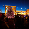 Festival goers look on as officials light up the tree at the corner of State and Market streets during the New Albany Holiday Festival on Saturday evening. Staff photo by Christopher Fryer