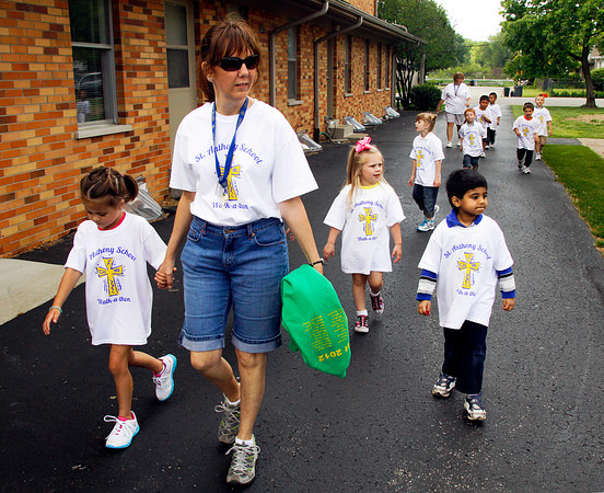 Bedeva Steurer leads her preschool class through campus during the St. Anthony of Padua Catholic School Walkathon in Clarksville on Friday afternoon. Students, faculty and parents took part in the PTO fundraiser to raise money for the school. Staff photo by Christopher Fryer