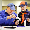 "Cub Scout Mattison Payne, 7, of pack 69 out of New Albany, gets a little help from his father, Matt, as they put the finishing touches on ""Gunter"", his felt penguin creation, at the Carnegie Center's Family Fun Workshop on Saturday morning in New Albany. Around 45 participants built penguins using toilet paper tubes, felt, craft foam, baby socks, wiggle eyes, pom poms, and ribbon at the workshop. The center hosts the event on the second Saturday of every month and the crafts vary depending on the season, an upcoming holiday, or a current exhibit. Staff photo by Christopher Fryer"