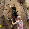 Michael Barnett, of Clarksville, gives Chase Jarrell, 8, of Jeffersonville, a boost while he climbs the rock wall at the Floyd County YMCA in New Albany on Thursday evening. Barnett has been mentoring Jarrell for about a year through Big Brothers Big Sisters of Kentuckiana. Staff photo by Christopher Fryer