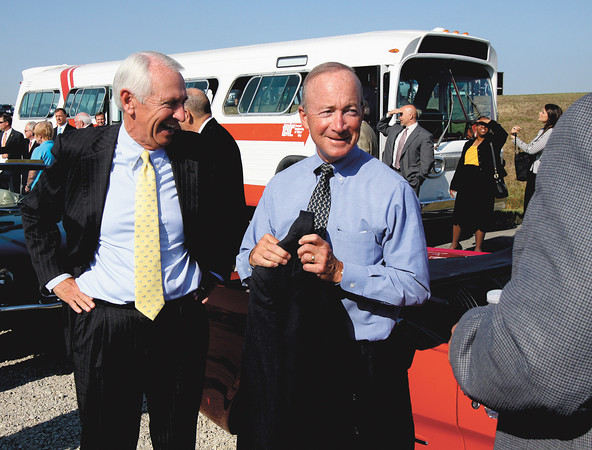 Kentucky Gov. Steve Beshear jokes with Indiana Gov. Mitch Daniels as they arrive for the East End Bridge Crossing groundbreaking Thursday in Jeffersonville. Staff photo by C.E. Branham