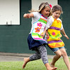Olivia Schrink, left, and Kennedy Lee chase down a soccer ball while participating in the Floyd County 4-H Project Day Camp. Topics of the three-day camp include Science, Health, Arts & Crafts, and Environment. Participants will finish at least four projects that will be ready to be exhibited at the 4-H Fair in July. Staff photo by C.E. Branham