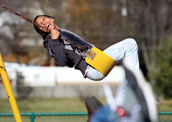 Thomas Jefferson Elementary School fifth-grader Na-imah Slaughter and classmates enjoy unseasonably warm temperatures Thursday on the playground.  Staff photo by C.E. Branham