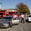 Emergency crews clean up the scene of a two vehicle injury accident after the driver of a Honda Odyssey minivan failed to yield to a Buick LeSabre sedan at the intersection of East 13th and Spring streets in New Albany on Wednesday afternoon. The driver of the minivan was arrested for never having a license. Staff photo by Christopher Fryer