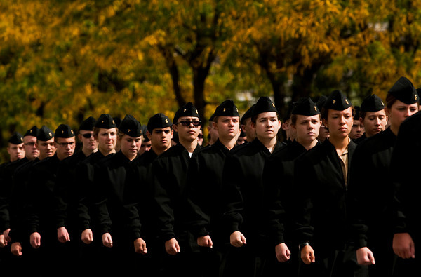 The Floyd Central High School Navy JROTC marches down Spring Street during the Harvest Homecoming Parade in New Albany on Saturday afternoon. Staff photo by Christopher Fryer