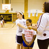 Teen Work Experience program volunteers Abby Ferree, 16, left, and MiKayla Moore, 17, right, team up with Elaina Culpepper, 8, while playing the squirrel and the hound in the gymnasium at the Griffin Recreation Center in New Albany on Thursday morning. The program was started this year by the New Albany Parks Department to help teenagers learn job skills. Staff photo by Christopher Fryer