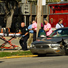 Emergency crews work the scene of a two vehicle injury accident after the driver of a Honda Odyssey minivan failed to yield to a Buick LeSabre sedan at the intersection of East 13th and Spring streets in New Albany on Wednesday afternoon. The driver of the minivan was arrested for never having a license. Staff photo by Christopher Fryer
