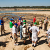 Naturalist Connie Farmer leads a group of visitors on a fossil bed tour during Earth Discovery Day at the Falls of the Ohio State Park in Clarksville on Saturday morning. Staff photo by Christopher Fryer