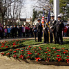 The Floyd Central High School Navy JROTC color guard and the Hazelwood Middle School fifth-grade class participate in a wreath laying ceremony at the New Albany National Cemetery on Friday afternoon. The students placed 270 wreaths around the cemetery to honor veterans for the holiday season as part of Wreaths Across America. Staff photo by Christopher Fryer