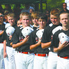 The New Albany 11-12 All-Stars stand for the national anthem before their Little League District V tournament game against HYR Saturday evening. The District V tourney opened Saturday at Mt. Tabor Park in New Albany. Staff photo by C.E. Branham
