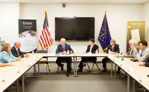 Indiana Gov. Mike Pence speaks with participants before a round table discussion at the Purdue University College of Technology at New Albany following his tour of the school on Friday afternoon. Staff photo by Christopher Fryer