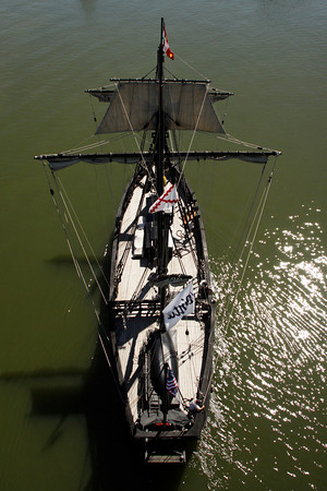 A Replica of the Christopher Columbus ship, the Pinta, is sailed up the Ohio River to dock in downtown Louisville on Tuesday. Every three years replicas of the Niña and the Pinta are sailed from the Gulf of Mexico, up the East Coast, over to the Great Lakes, and through various waterways and rivers to eventually go up the Ohio River and end the journey in Pittsburgh. They are docked at various ports along the way for educational tours and will be open next to Joe's Crab Shack, 131 West River Rd., through September 4. Staff photo by Christopher Fryer