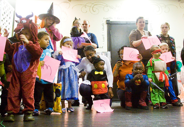 Participants and parents stand on stage for judging during the costume contest at the 27th annual Costume Carnival in Newlin Hall at the Floyd County 4-H Fairgrounds on Thursday evening. About 50 businesses and organizations were also at the event with trick-or-treat and game stations set up in the hall. Staff photo by Christopher Fryer