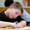 Carson Mumaw, second-grader at Slate Run Elementary, works on his page for the New Albany Bicentennial Scrapbook Project. Students in Mary Arnold's class at the school will continue to work on the projects this week. Staff photo by Jerod Clapp