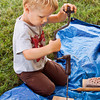 Herman Wood, 4, Louisville, uses a hand drill at the then and now station during the annual Archaeology Day at Falls of the Ohio State Park in Clarksville on Saturday morning. Staff photo by Christopher Fryer