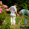 Officers from the New Albany Police Department work in the backyard of the home of William Clyde Gibson III on the 800 block of Woodbourne Drive in New Albany on Wednesday afternoon. Staff photo by Christopher Fryer