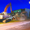 The City of Jeffersonville began demolishing a portion of the former Tubby's Pizza building on Spring St. late Thursday evening. Staff photo by C.E. Branham