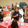 Neighborhood residents Robin and Loreal Edelen, both of New Albany, look over oral health information at a station with volunteer Lisa Moreschi, of New Albany, during a health fair at Northside Christian Church on Oak in New Albany on Saturday afternoon. Around 60 local residents came to the event where stations were set up to provide information on various health topics as part of Northside's Serve Day. The church teamed up with a group of seven Indiana University Southeast students, with a community project requirement, to help organize and run the event. Staff photo by Christopher Fryer