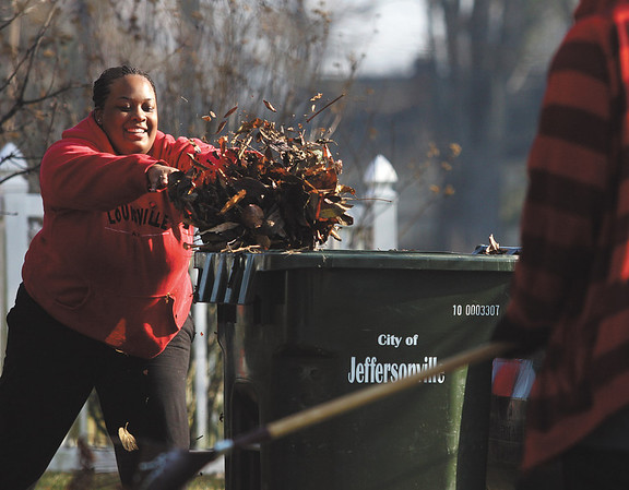 Joy Beasley, above, and more than 20 other volunteers from United Parcel Service teamed up Friday morning to prune, clean, and mulch the landscaping around the homes at Noah's Ark Children's Village in Jeffersonville.  Staff photo by C.E. Branham