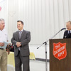 Dale Oren, left, is presented a Lifetime Board Member plaque by Board Chairman Todd Lancaster, center, and Corps Officer Stephen Kiger in recognition of his 26 years of service during the Salvation Army Volunteer Luncheon in New Albany on Wednesday afternoon. Staff photo by Christopher Fryer