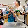 Heidi Estes, left, and Alyssa Ochsner prep masks and mouth pieces before submerging their heads in a bin of water in the scuba diving class during Learn at Every Turn at Floyds Knobs Elementary School on Friday morning. Staff photo by Christopher Fryer