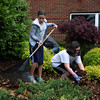Stevie Roth, a sixth-grader at Hazelwood Middle School, and Cheyenne Helton, a fifth-grader, rake up leaves at the school at Hazelwood Gives a Day on Saturday. Students, parents, teachers and staff did a little spring cleaning outside the school. Staff photo by Jerod Clapp