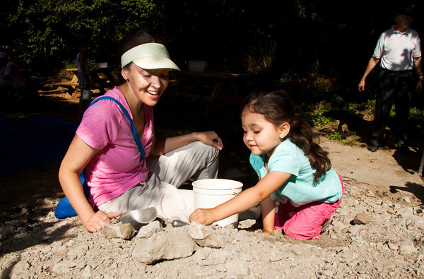 Anabella Doogarsingh, 3, Louisville, digs through a mineral collecting pile with her mother Danielle Horton during Earth Discovery Day at the Falls of the Ohio State Park in Clarksville on Saturday morning. Staff photo by Christopher Fryer