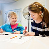 Ella, 9, left, and Annmarie Tichy, 12, both of New Albany, carve designs into a block to be used for printing during a relief printing workshop at the Carnegie Center in New Albany on Saturday afternoon. Staff photo by Christopher Fryer