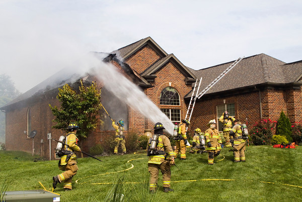 Firefighters work the scene of a house fire at 4009 Cicalla Court in the Jackson Springs development in Greenville on Thursday morning. No one was injured in the fire, which started at about 10 a.m. Staff photo by Christopher Fryer