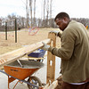 Jay Samuels with Cardinal Fencing installs a split rail fence in Vissing Park. The new Jeffersonville park is expected to be finished by March. Staff photo by C.E. Branham