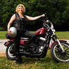 Sharon Fink, owner of Fink's, stands with her Harley Davidson Sportster next to her business in New Albany. She has a large women's section of gear, apparel and accessories in her store to cater to the growing number of female motorcyclists. Staff photo by Christopher Fryer