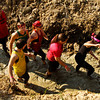 Racers make their way up a trench during the Muddy Fanatic 5K Adventure Race at the former Glenwood Training Center in Sellersburg on Saturday morning. Over 2000 participants negotiated over 30 obstacles on a 3.1 mile course either as individual racers or as part of a team. Staff photo by Christopher Fryer
