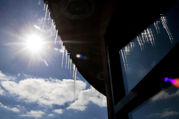 Icicles hang from the roof of Chick-fil-A along State Street in New Albany on Friday afternoon. Up to 2 inches of snow are expected in Southern Indiana today with a high of 33. Staff photo by Christopher Fryer