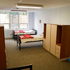 Beds and and cabinets sit in a dormitory room of the new Open Door Youth Services facility at the recently opened Pine View Government Center on Corydon Pike in New Albany on Tuesday afternoon. The facility has both boys and girls dormitories with the capacity to house up to 18 occupants. Staff photo by Christopher Fryer