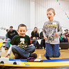 Cub Scouts Jakob Hoyer, 6, left, and Elijah Hunt, 7, both of pack 4020 out of Georgetown, react as their pinewood derby cars cross the finish line during the Test & Tune Pinewood Derby Race at Georgetown Christian Church on Saturday morning. More than 30 participants brought their cars to the event to test and tweak their performance before the official race on February 2. Staff photo by Christopher Fryer