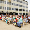 Attendants sit in front of the City-County Building during the 62nd Annual National Day of Prayer in downtown New Albany on Thursday afternoon. Local community and religious figures led prayers for government and civil servants, media, education, business, non-profits, and churches during the ceremony. Staff photo by Christopher Fryer