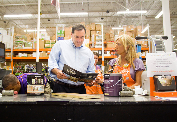Sen. Joe Donnelly talks with paint technician Deanna McLaughlin, New Albany, while visiting Home Depot during his Serving Those Who Serve Defense Jobs Tour on Tuesday afternoon in New Albany. Staff photo by Christopher Fryer