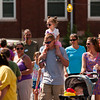 Nathan Smith, Borden, carries his daughter Trinity, 2, on his shoulders as they make their way between booths and games at the annual Mount St. Francis Picnic in Floyds Knobs on Saturday afternoon. Staff photo by Christopher Fryer