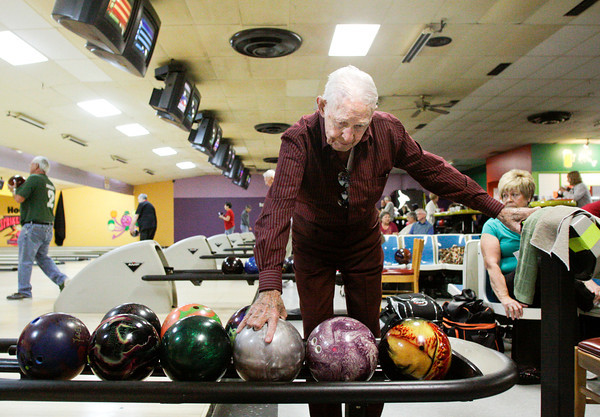 Jack Oberhausen, of New Albany, prepares to roll a frame during the Tuesday Hoosier Senior League at Hoosier Strike and Spare Family Fun Center along State Street in New Albany. Oberhausen is the oldest person in the league and will be turning 98 on Thursday. Staff photo by Christopher Fryer