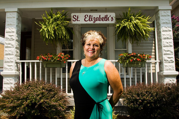 Melinda Spaulding stands outside of St. Elizabeth Catholic Ministries during a luncheon in honor of her retirement from the agency on Friday afternoon in New Albany. Spaulding worked as a residential caretaker for 24 years. Staff photo by Christopher Fryer