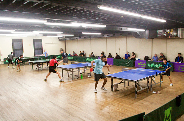 Players face off during the 28th annual Bernard Hock Open Table Tennis Tournament at the Ed Endres Boys & Girls Club complex in New Albany on Saturday. The two-day event featured 47 players from around the country competing in both singles and team matches. Staff photo by Christopher Fryer