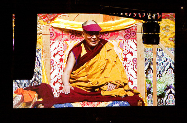 The image of the Dalai Lama is projected on an overhead screen as he speaks during a Buddhist teaching at the KFC Yum! Center in Louisville on Monday morning. Staff photo by Christopher Fryer