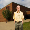 Jim Morris, Jeffersonville, stands in front of the Activities Building at Indiana University Southeast in New Albany on Wednesday morning. Morris retired from IU Southeast in 2000 after coaching the mens basketball team and serving as the athletic director for 25 years. Staff photo by Christopher Fryer