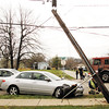 Utility and emergency crews manage the scene of an accident at the intersection of Greenvalley Road and Gordan Drive in New Albany on Friday afternoon. No one was injured in the accident. Staff photo by Christopher Fryer