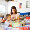Tracy Miller, Sellersburg, looks for home schooling materials with her son Trevor, 6, during a school supplies sale in the gymnasium at the former St. Mary's Catholic Academy in New Albany on Thursday afternoon. Staff photo by Christopher Fryer